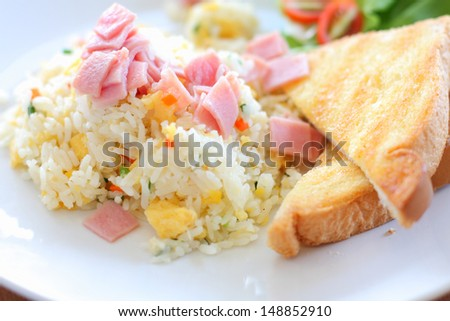 Fried rice with ham, served with toast