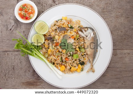 Fried rice with mackerel, egg, carrots, kale, spinach, egg yolk. Chili and fish sauce , thai food, Clean Food. - stock photo