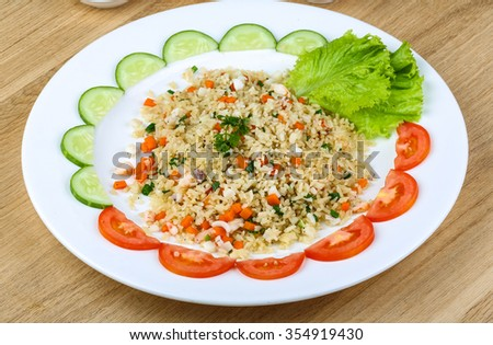 Fried rice with seafood served tomato and cucumbers - stock photo