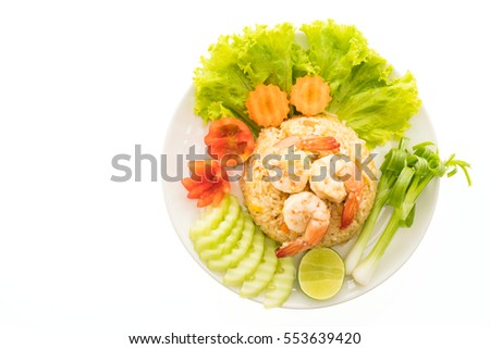 Fried rice with shrimp and prawn on top in white plate isolated on white background