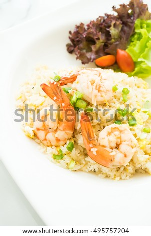 Fried rice with shrimp and vegetable in white plate