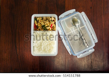 Fried rice with the tupperware box.with steamed rice.