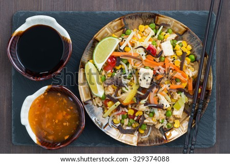 fried rice with tofu and vegetables, close-up, top view - stock photo