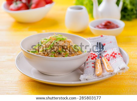 Fried rice with vegetables and green onion, fresh tomatoes and sauces