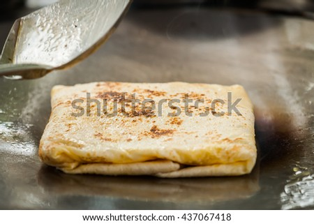 Fried roti with egg and banana,Thailand