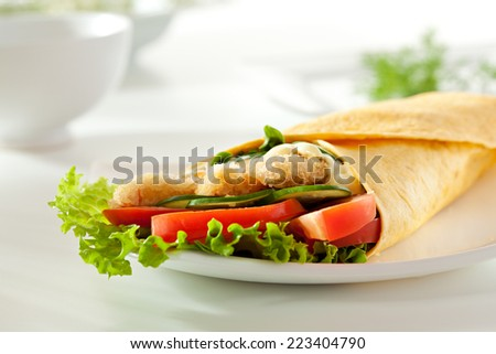 Fried Salmon Burrito with Vegetables - stock photo