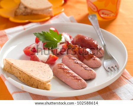 Fried sausage with tomato salad for breakfast, selective focus