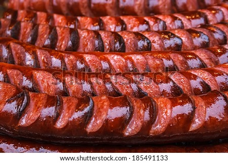 Fried sausages, lined up to be served.