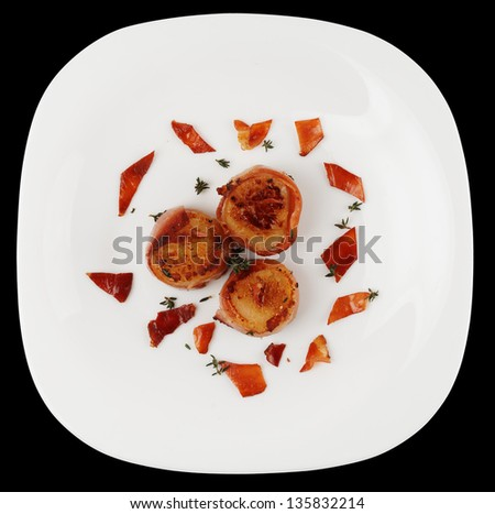 Fried scallops  on plate isolated on black background - stock photo