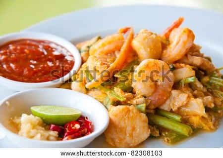 fried seafood Sukiyaki in Thai style with sauce - stock photo