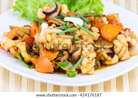 Fried seafood with vegetable on white disc for dinner