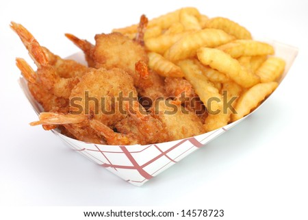 Fried shrimp and french fries basket isolated on white background. - stock photo