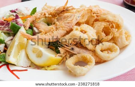 Fried shrimp and squid with lemon, italian food. - stock photo