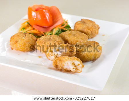 Fried shrimp cake pour with sweet sauce, Thai food
