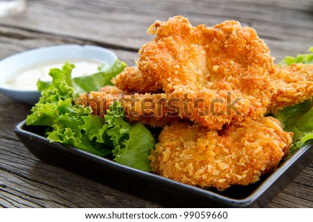 fried shrimp meat ball with sweet sauce on wooden table