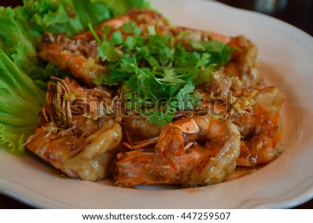 fried shrimp with tamarind sauce,  wood table, white dish, food of Thailand
