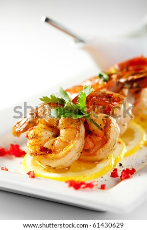Fried Shrimps on Lemon Carpaccio with Sauce - stock photo