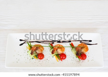 Fried shrimps restaurant serving flat lay, copyspace on white wooden background, horizontal orientation - stock photo