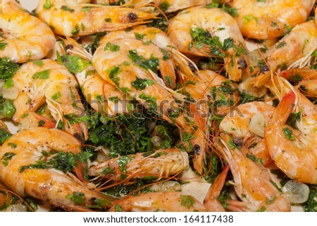 Fried shrimps with the garlic and the parsley - stock photo