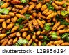 Fried silkworms with Pandan  at night market Thailand - stock photo