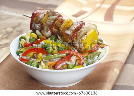 Fried skewers and rice with vegetables