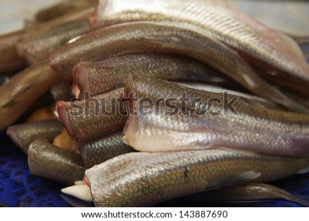 Fried small smelt fish in a pan