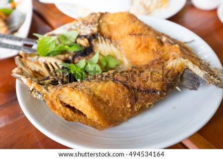 Fried snapper topped with sweet fish sauce with herbs