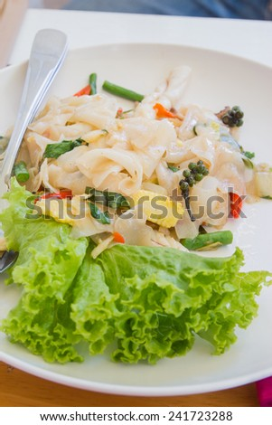 Fried spicy noodle seafood on white dish - stock photo