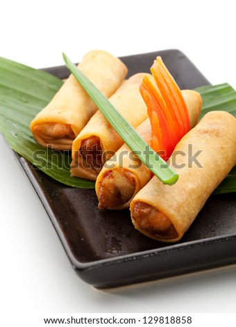 Fried Spring Rolls on Black Dish - stock photo