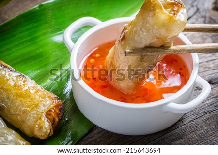 Fried spring rolls serves with sweet and sour sauce - stock photo
