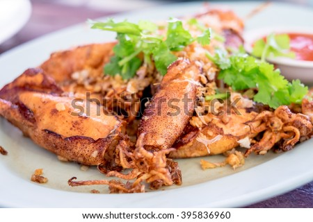 Fried Squid with Garlic in blue plate