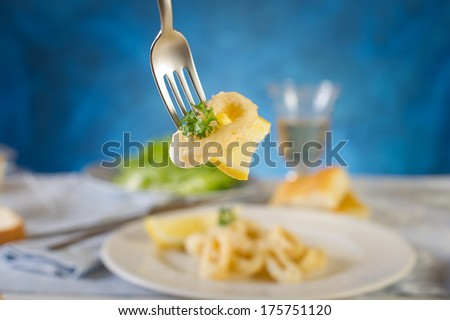 fried squid with lemon  - stock photo