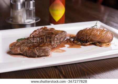 fried steak on a white plate