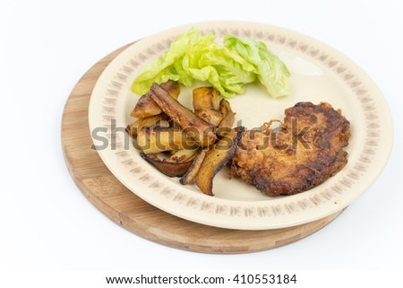 Fried steak potatoes and lettuce. - stock photo