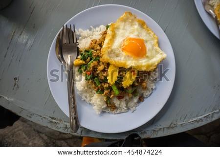 Fried Stir Basil with Minced pork and Fried egg. Thailand food. - stock photo