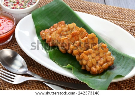 fried tempeh, indonesian food, vegetarian food, soybean product, tempeh goreng - stock photo
