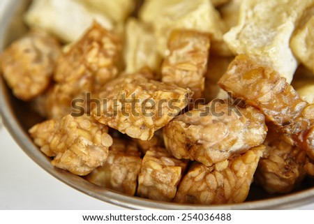 Fried tempeh, special fermented soya beans from Indonesia - stock photo