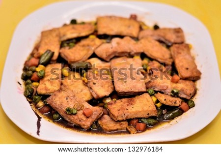 Fried tofu curd with beans dish - stock photo