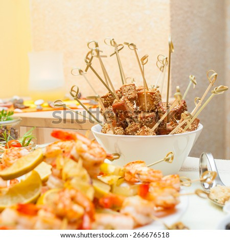 Fried tofu sticks with sesame on a tapas and appetizers table - stock photo