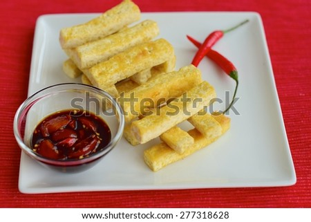 Fried Tofu Sticks with Thick Soy Sauce Chili Tomato Dip - stock photo