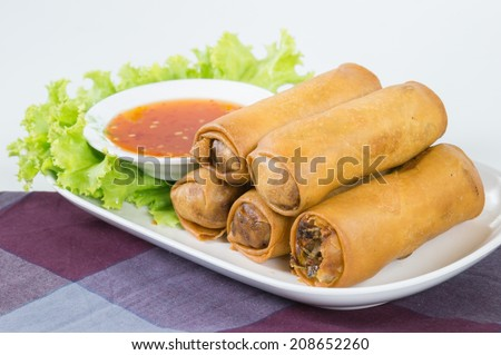 Fried Vegetable egg roll, spring roll, cabbage, silver noodles, carrots, celery, mushrooms, taros, thai sweet sauce - stock photo