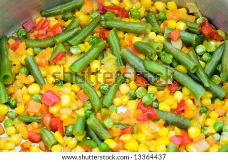 Fried vegetables in a frying pan close up - stock photo