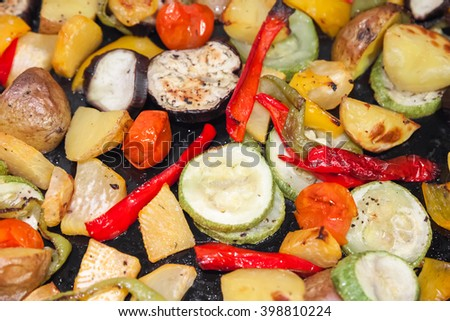 Fried vegetables in a frying pan. Closeup photo with selective focus and shallow DOF - stock photo