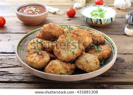 fried vegetables meatballs on kitchen table background - stock photo