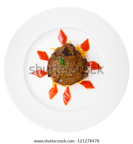 Fried venison in porcelain plate, isolated on black background - stock photo