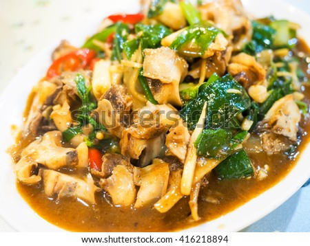 fried whelk with basil