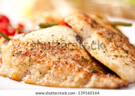 Fried whitefish with vegetables