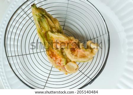 Fried zucchini blossom close up background - stock photo