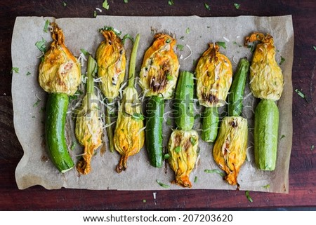 Fried zucchini flowers stuffed with cream cheese, ricotta, tasty Italian dish summer - stock photo