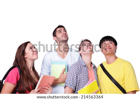 Friend group of happy students look up forward isolated over a white background,  caucasian and asian